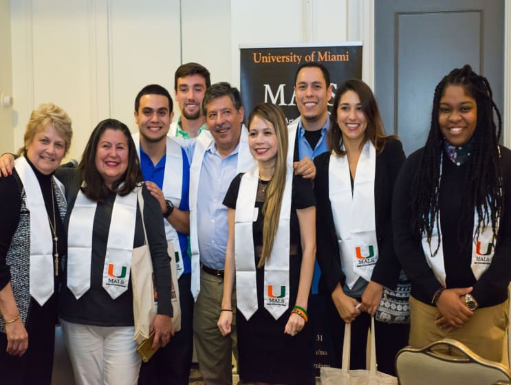 A group of University of Miami MALS students and their graduation dinner.