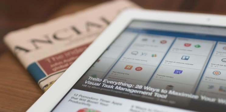 Tablet on a newspaper