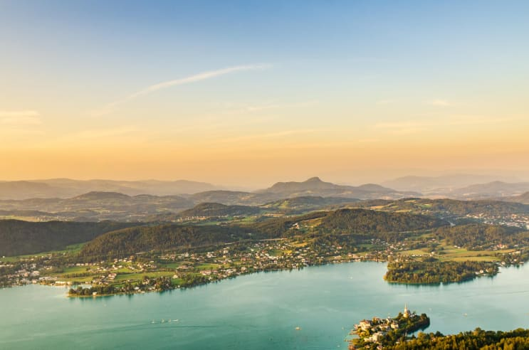 Lake and mountains at Worthersee Karnten Austria. View from Pyramidenkogel tower on lake and Klagenfurt the area.