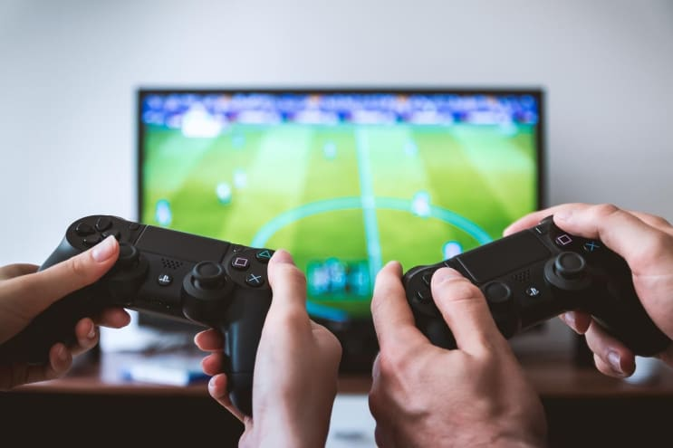 Hands holding the game controllers