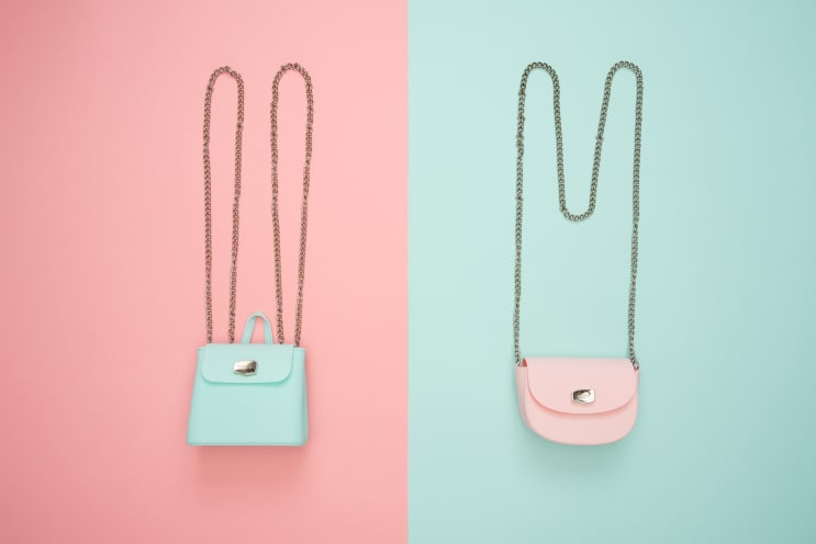 Pastel bags on pastel background
