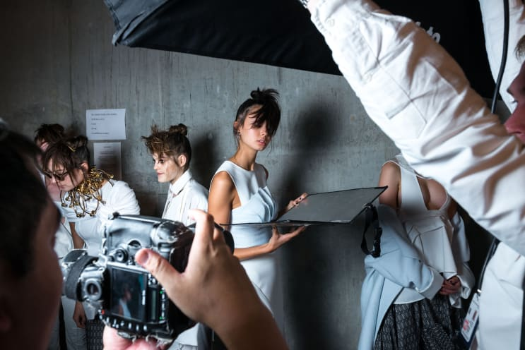 A model poses for photographers backstage at Mercedes-Benz Fashion Week.