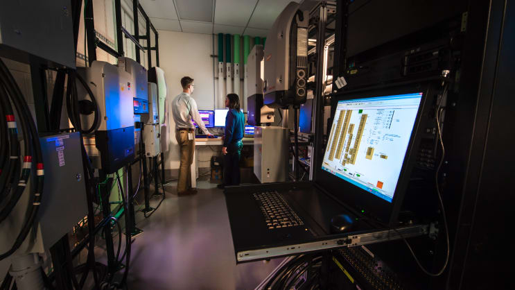NREL researchers work in the Systems Performance Laboratory (SPL) on the NODES program using multiple inverters.