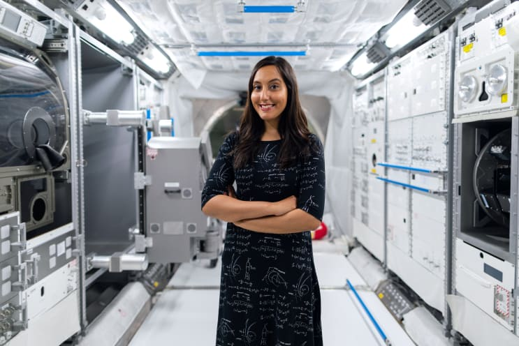 Female space operations engineer in space tunnel