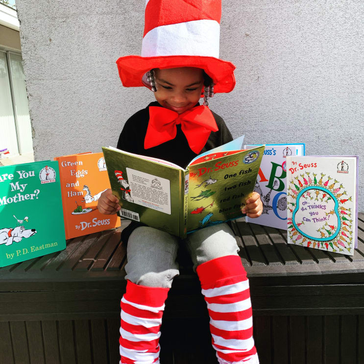 My Daughter for Dr.Suess week!  She loves reading and me too!