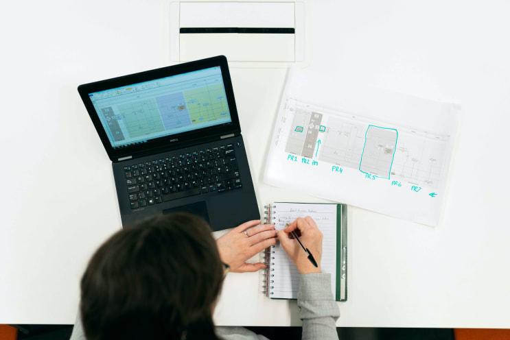 Female electronics engineer reviews data