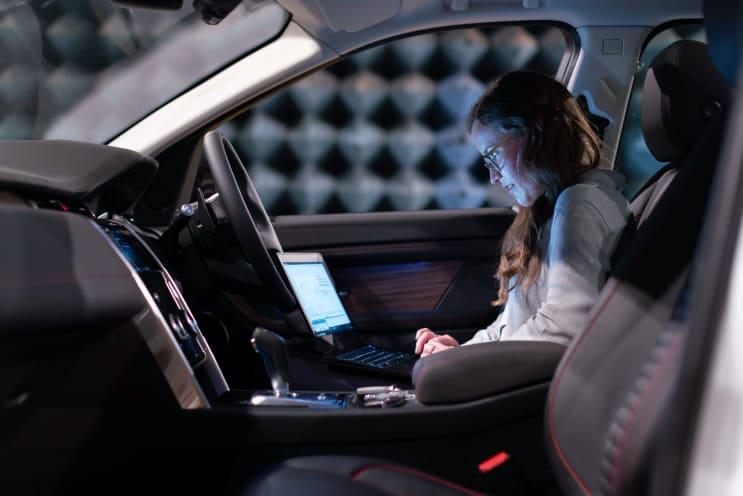 Female electronics engineer runs tests