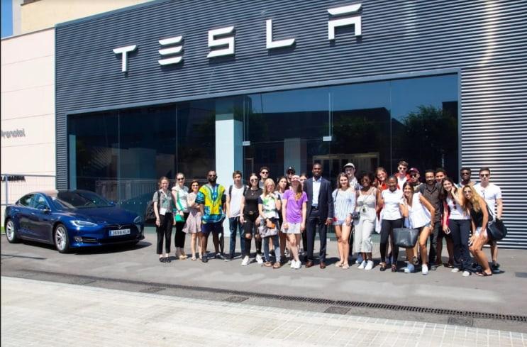 Students at a Tesla factory