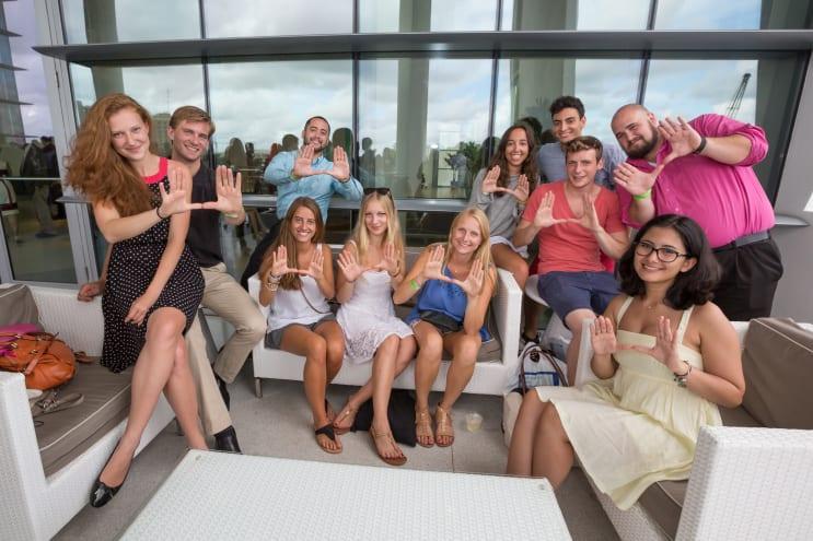 students on sofa